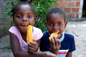 A boy and girl eating sweet potatoes