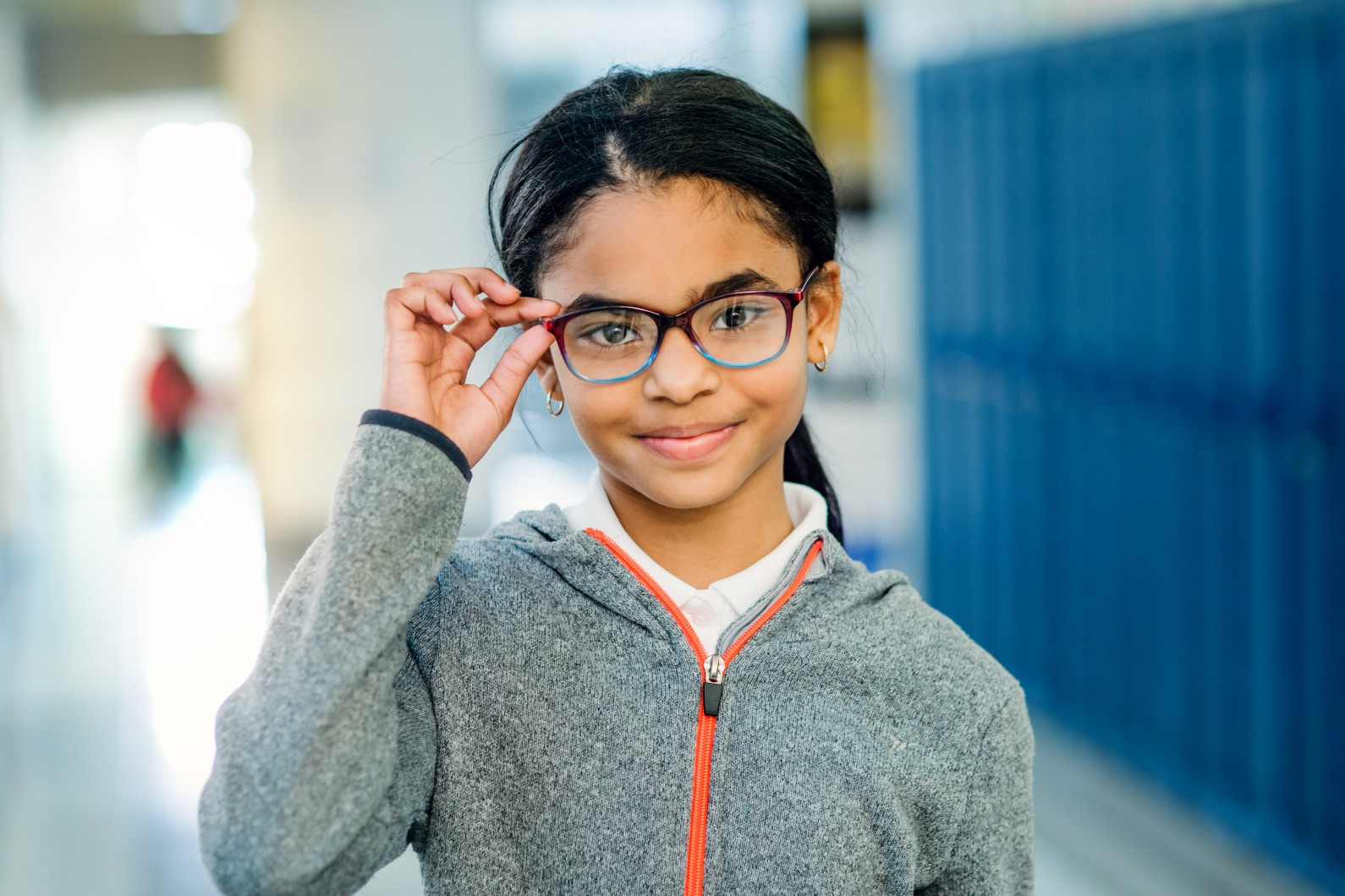 A student wearing glasses