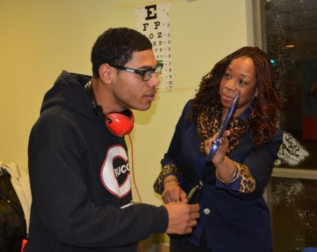 Program Manager Tonya Daniels helps youth select their new eyeglasses