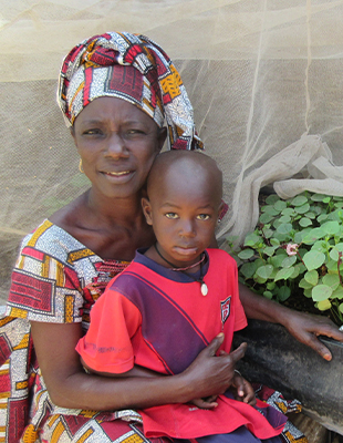Mother and Child in front of home garden.