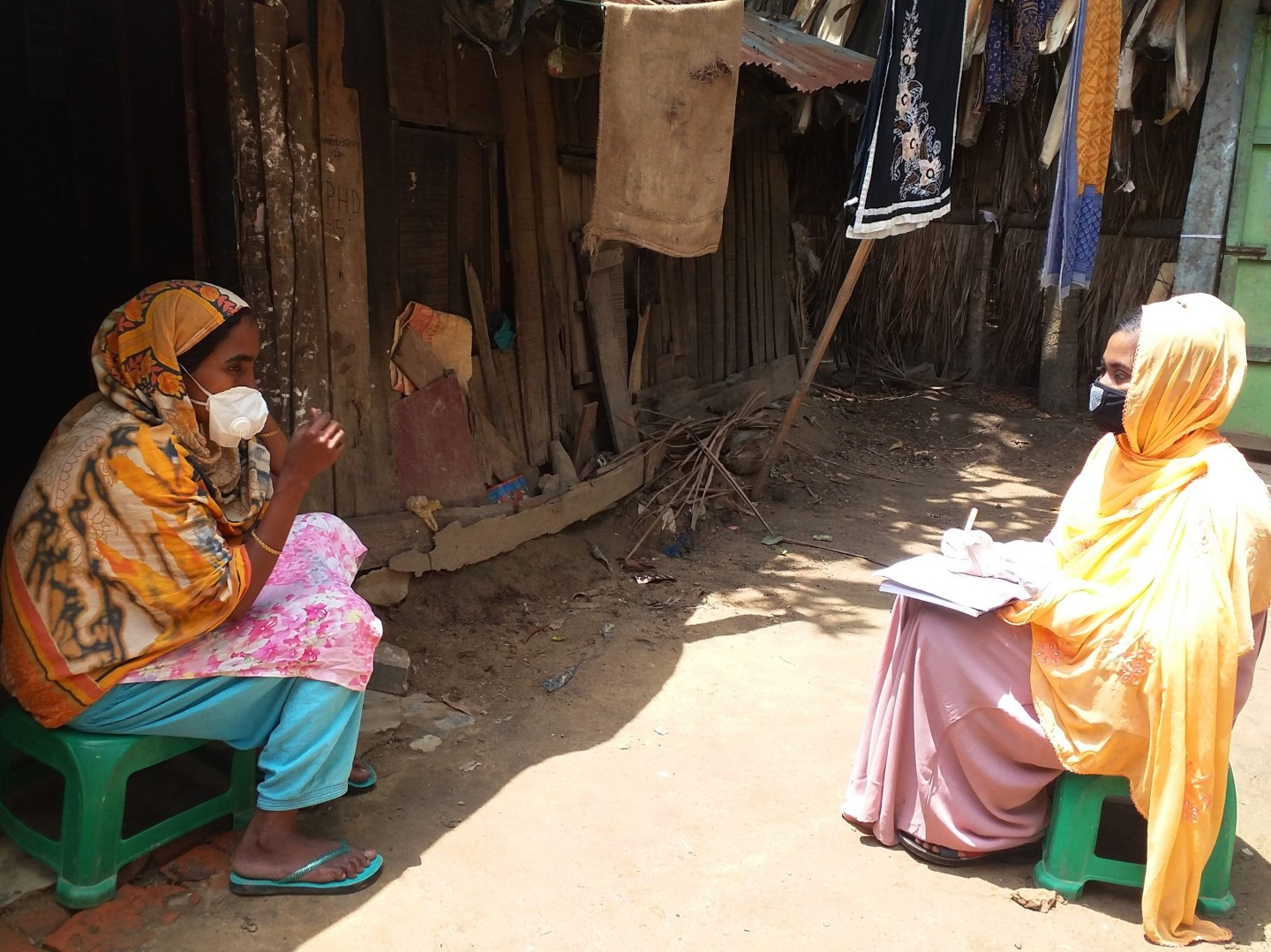A community facilitator visits a household to share hygiene and sanitation information