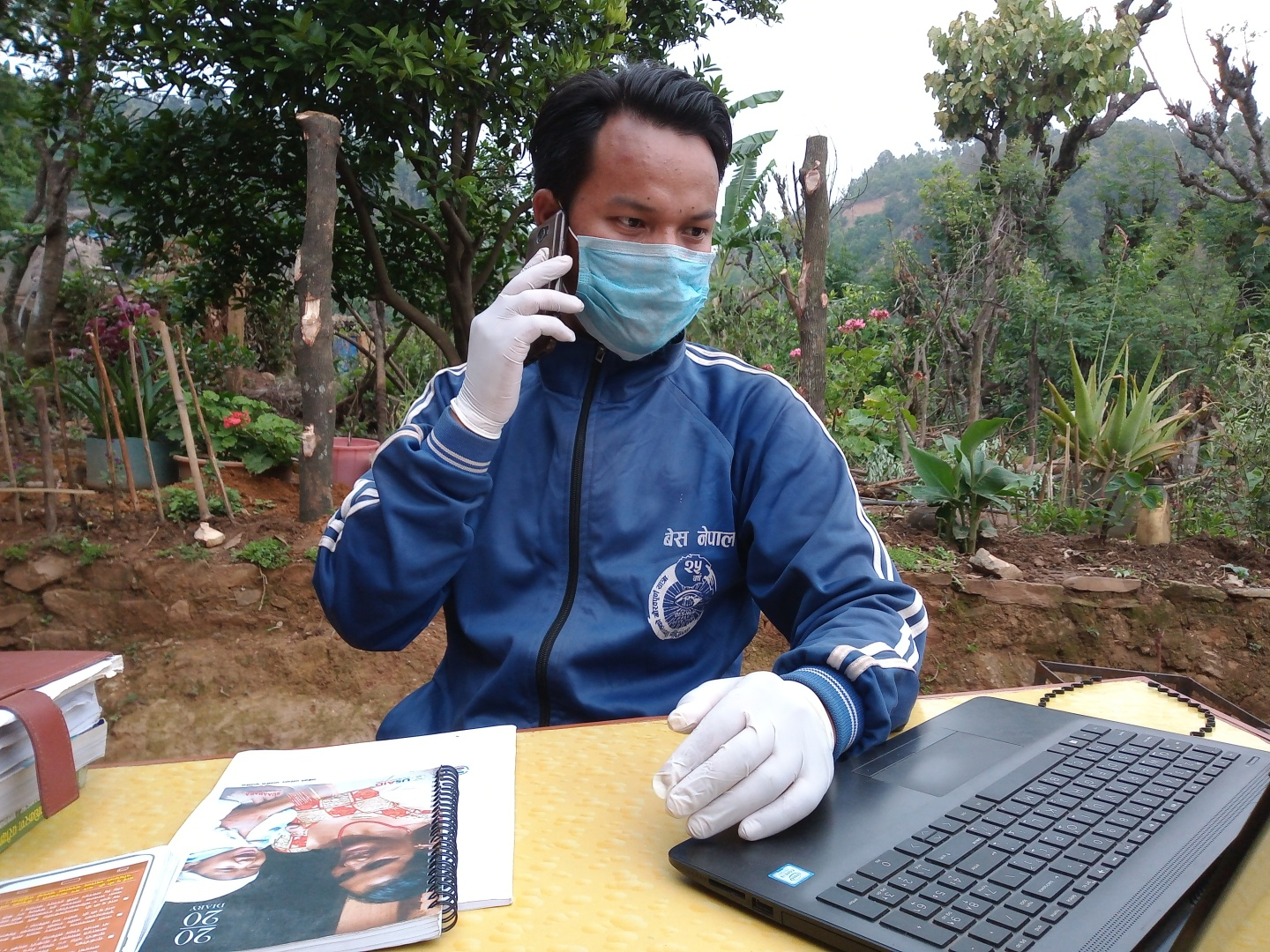 Sagar Hiski, Suaahara II Field Supervisor in Nepal's western Palpa district, counsels a breastfeeding mother about infant and young child nutrition over the phone.