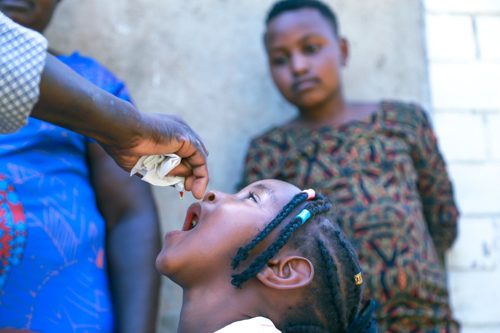 A young girl receiving a dose of Vitamin A.