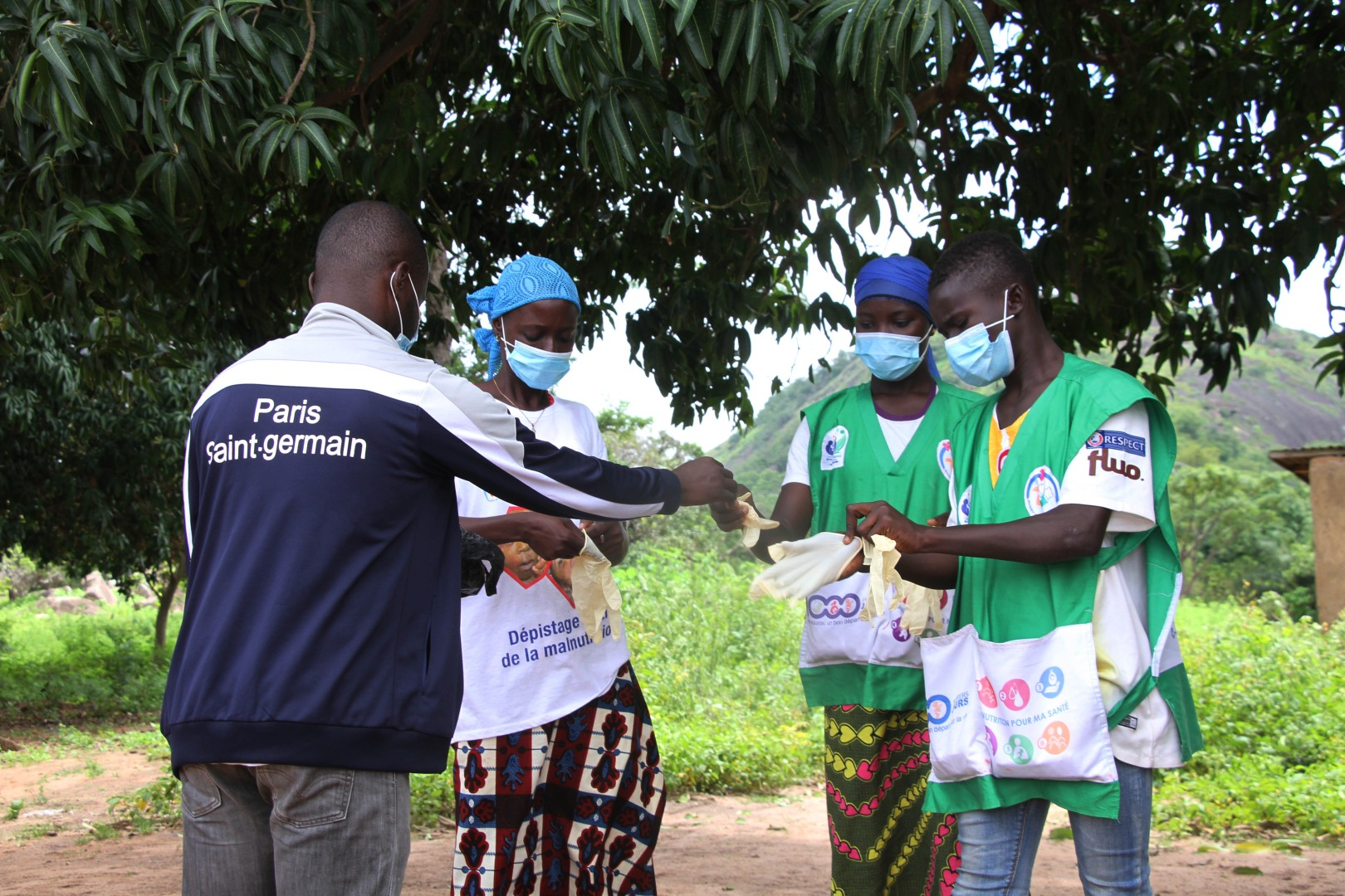 A team of vitamin A distributors dons masks and puts on gloves to prevent the spread of COVID.