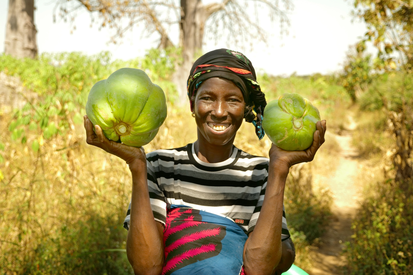 Mariam Tio holds two melons in her hands