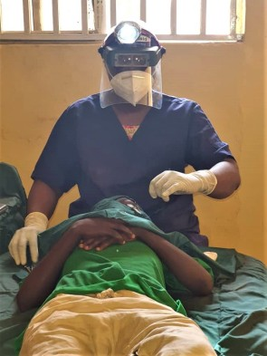 A health worker screening a patient for trachoma