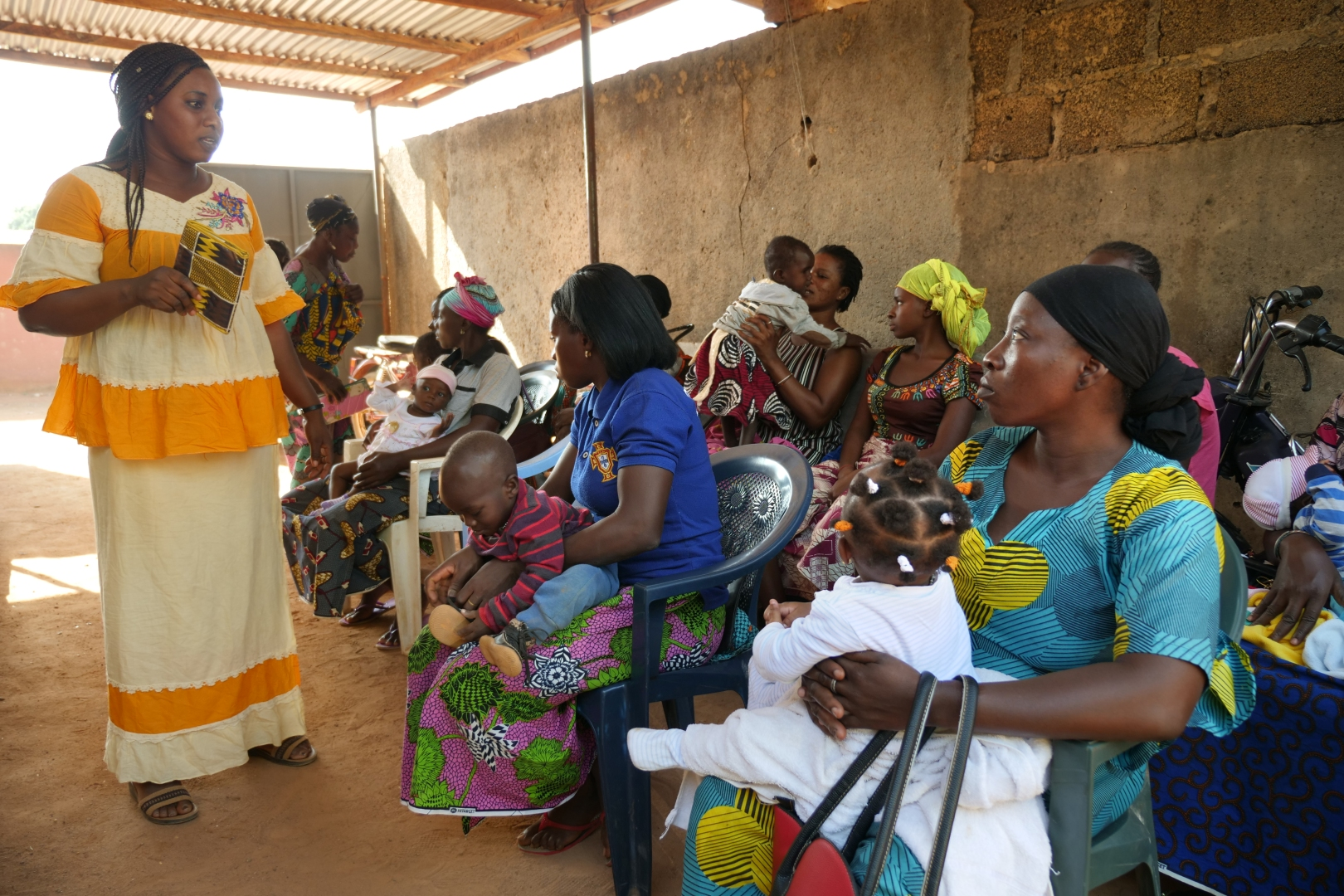 A Wo Pile Sanga employee talks to mothers from the community during an education session