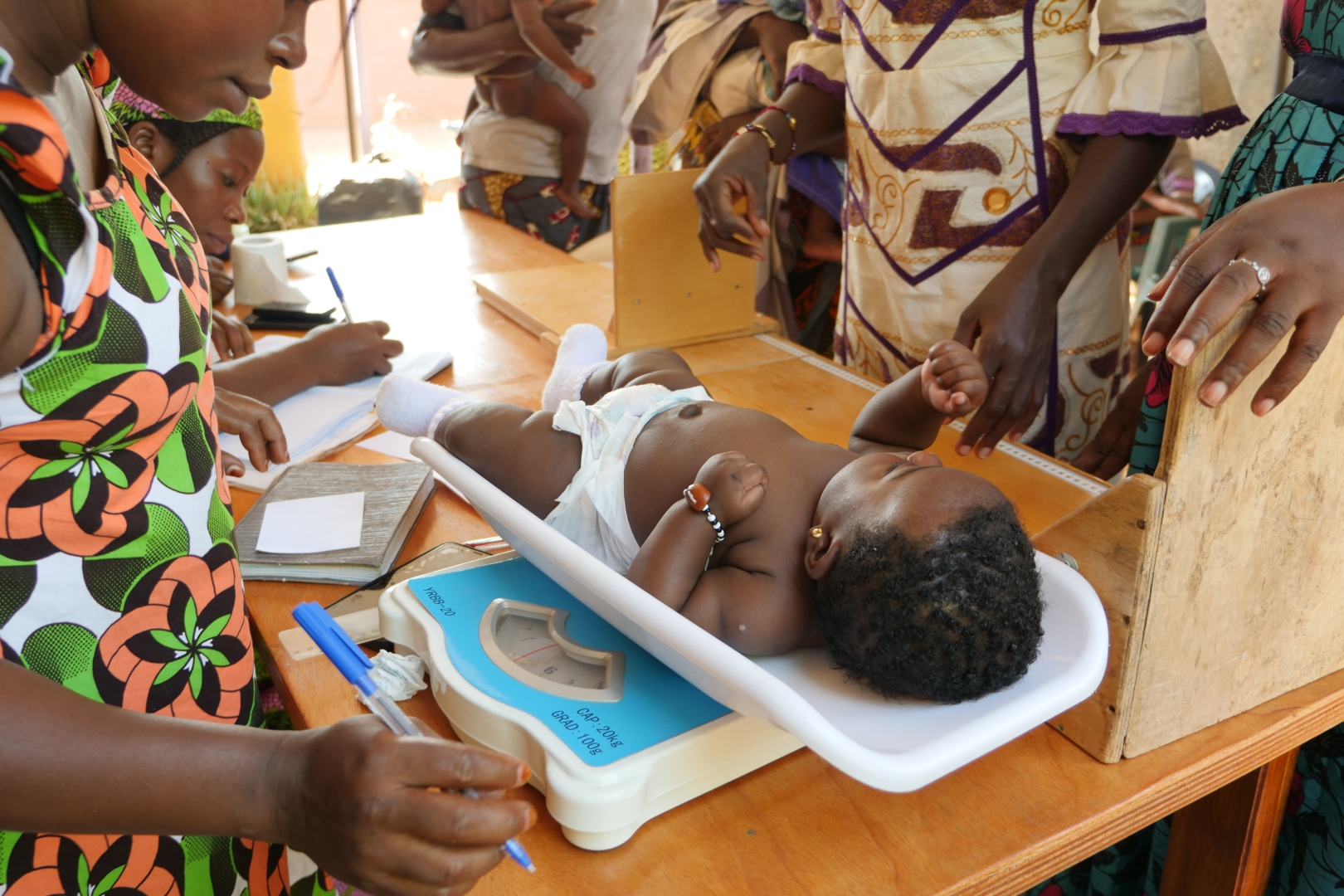 A small baby on a scale during a nutrition screening