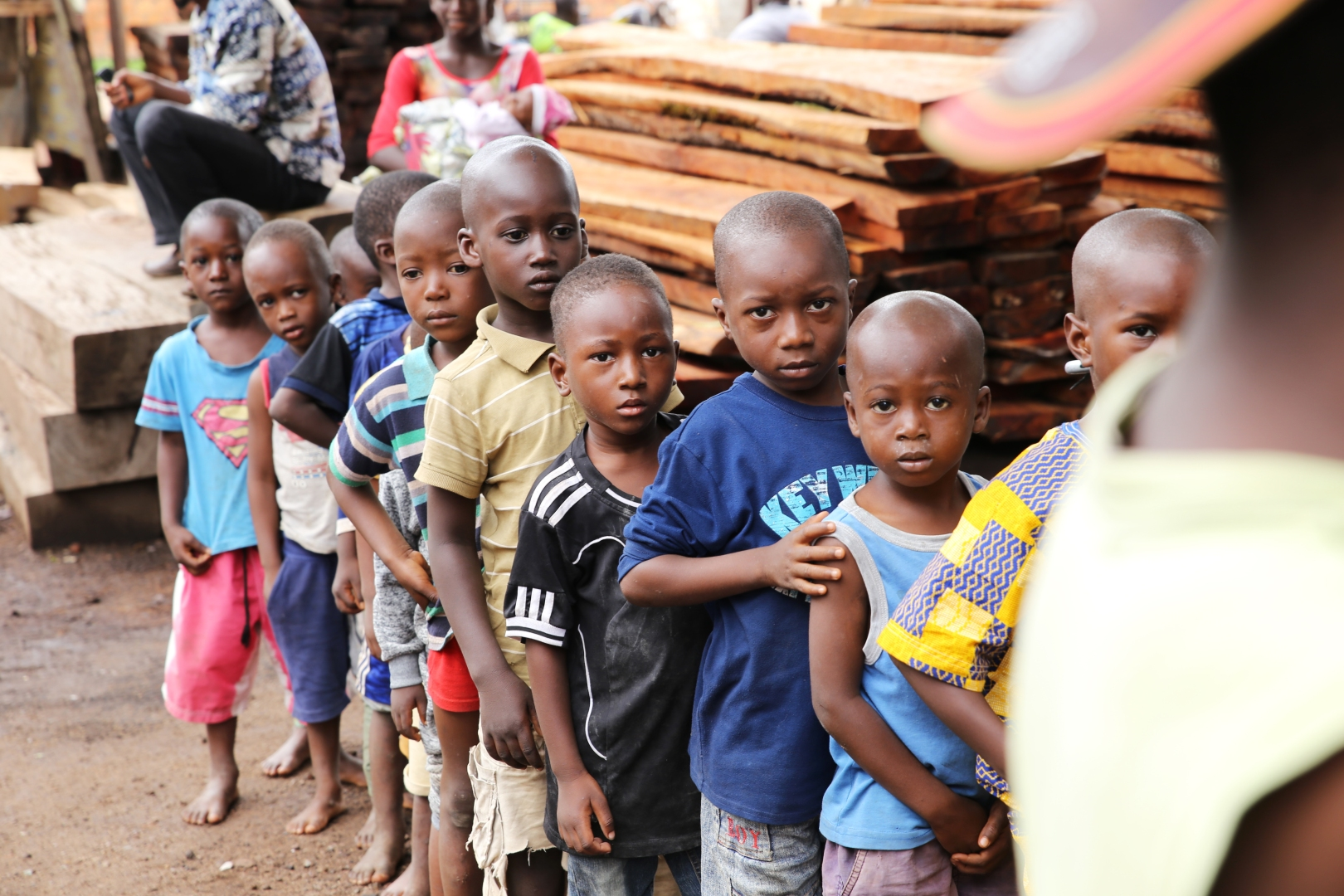 Children line up to receive vitamin A supplementation in Guinea.