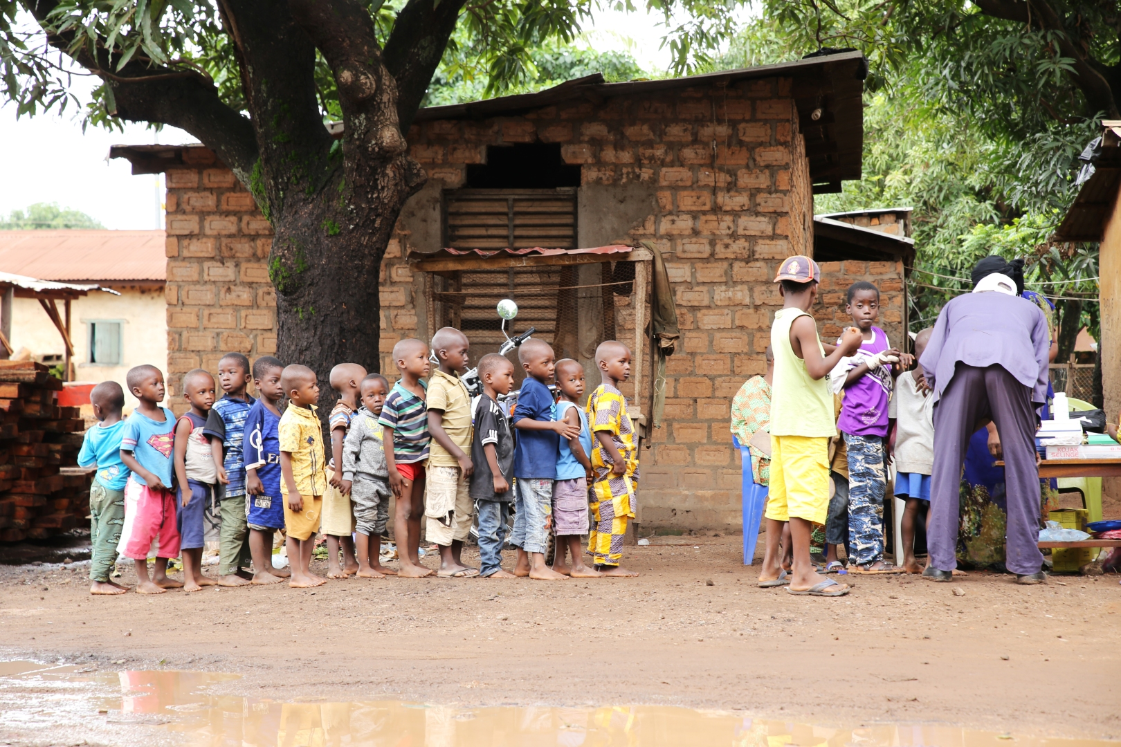 Children line up to receive vitamin A supplementation in Guinea