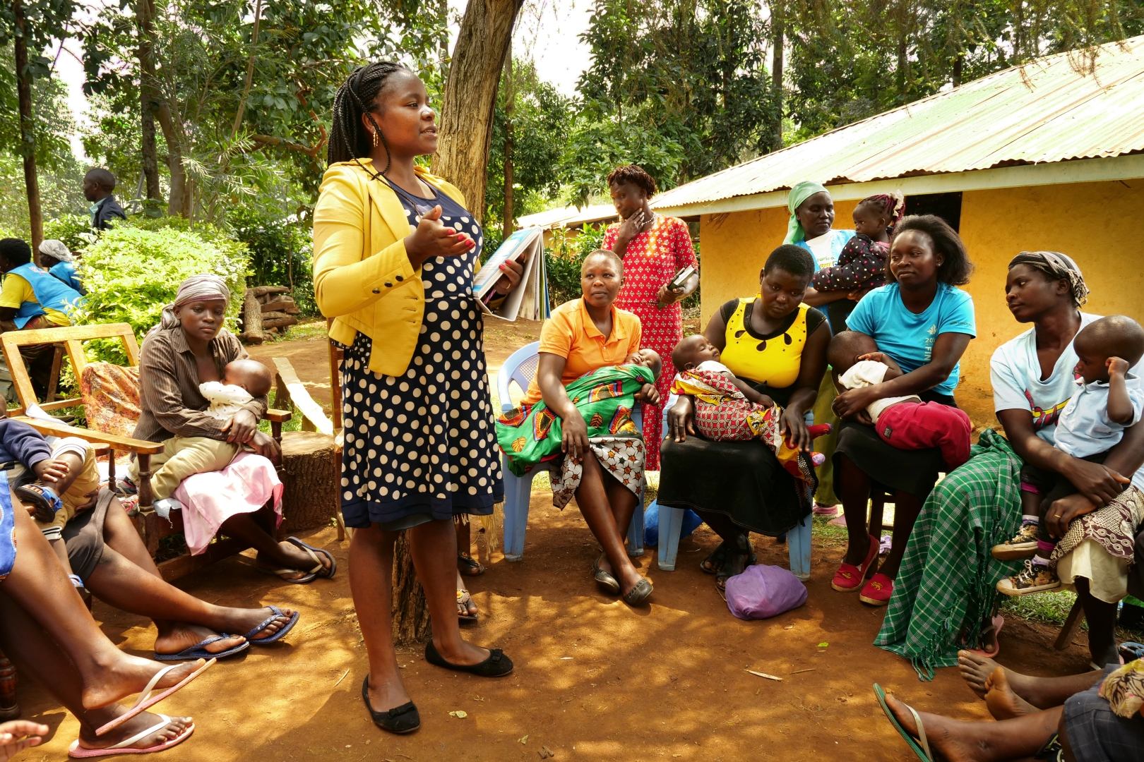 A woman leads a support group for mothers in Western Kenya