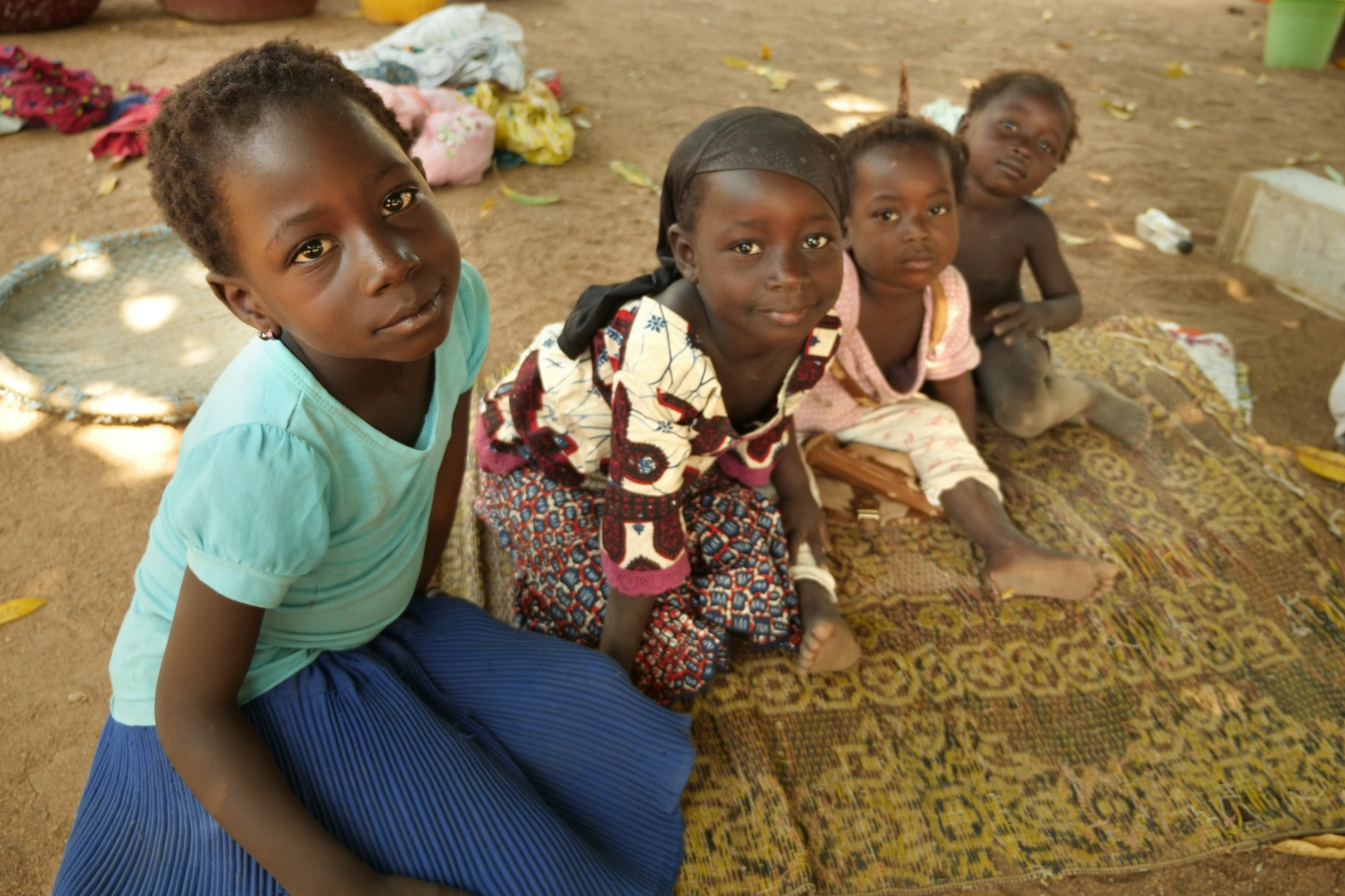 children in Cote d'Ivoire look at the camera