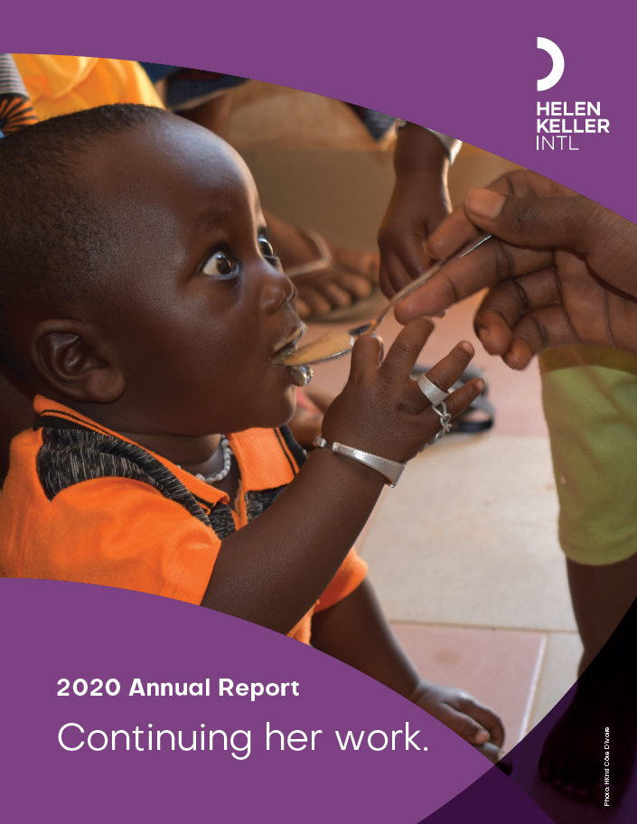 Annual Report Cover for Fiscal Year 2020, showing a small child receiving a spoonful of food
