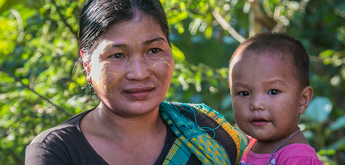 a woman farmer from Bangladesh, and her child